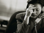 Frustrated Businesswoman on Telephone
